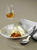 Canneloni with cloudberries and vanilla ice cream