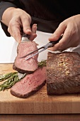 Roast beef being sliced