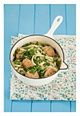 Smoked fish balls with tagliatelle, peas and chervil