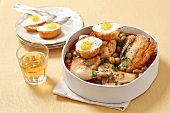 Pollo alla marengo (chicken ragout with quail's eggs and olives)