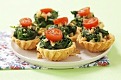 Spinach, walnut and tomato tartlets