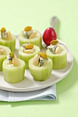 Cucumbers filled with blue cheese, almonds and pistachios