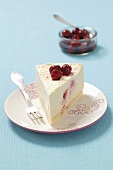 A slice of creamy cheesecake with sour cherries