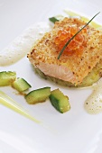 Salmon trout á la viennoise with cucumber on a bed of mashed potatoes