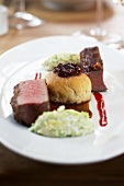 Saddle of venison with a dried fruit and nut crust and fig buchteln (baked, sweet yeast dumpling)