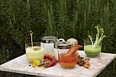 Various soups on a garden table