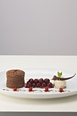 Chocolate pudding with spiced cherries and tonka bean ice cream