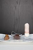 Chocolate ice cream with milk foam, chocolate ravioli and damsons