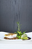 Fried bass with lentils and herbs