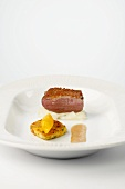 Pink duck breast with mustard sauce and potato roulade