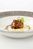 Braised duck leg on celery puree