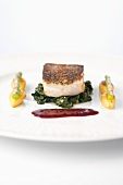 Fried hake fillet on beaujolais butter with spinach and nut potatoes