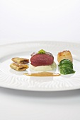 Saddle of venison and fried scallops with celery puree