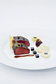 Braised saddle of venison with pistachios and caramelised red cabbage