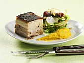 Pork belly with a side salad and pumpkin puree