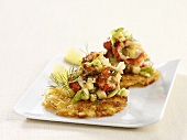 Potato cakes with crayfish salad