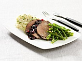 Roast wild boar with lingonberry sauce and green beans