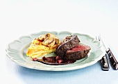 Elk fillet with cinnamon, redcurrants and root vegetable cake