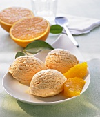 Orange ice cream with fresh orange slices