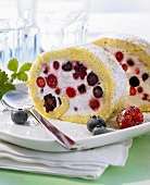 Iced sponge roll with berries