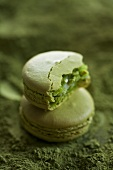 Matcha macaroons, one with a bite taken out