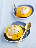 Mandarin sorbet with pistachios in peach halves