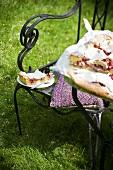 Rhubarb meringue cake on a garden chair