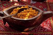 Curry powder in a wooden bowl