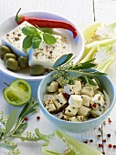Feta in bowls with olives and pepper