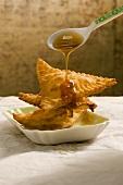 Sebadas (pastry pockets filled with pecorino and honey, Italy)