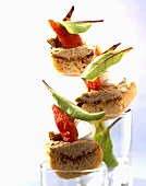 Canapes with olive tapenade, baby squid and tomato confit