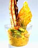 Saffron risotto with courgette flowers and fried bacon