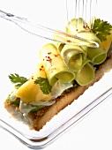Sliced avocado and king prawn carpaccio