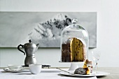 An Italian winter still life with an espresso jug and a panettone