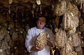 A butcher presenting Culatello di Zibello (ham speciality, Emilia Romagna, Italy)