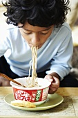 A child eating noodles