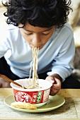 A child eating noodles