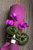 A napkin decorated with flowers and leaves (Cyclamen coum)