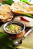 Paneer Saagwala (spinach with cheese, India) with naan bread and rice