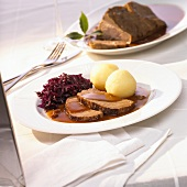 Rhineland Sauerbraten (braised beef in vinegar) with red cabbage and potato dumplings
