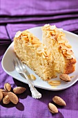 Two slices of yeast dough cake with slivered almonds