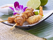 A sate kebab and fried prawns