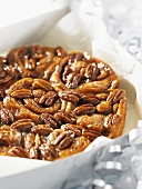 Sticky buns with pecan nuts in a box as a gift