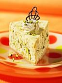 A slice of pistachio cheesecake