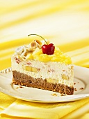 A slice of pineapple and banana split ice cream cake