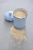 Oat bran in an enamel cup