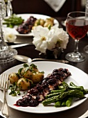 Goose breast with cranberry sauce, herb potatoes and green asparagus