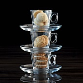A stack of espresso cups filled with different biscuits