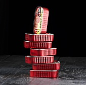 A stack of sardine tins