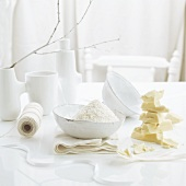 A piece of white chocolate and grated coconut